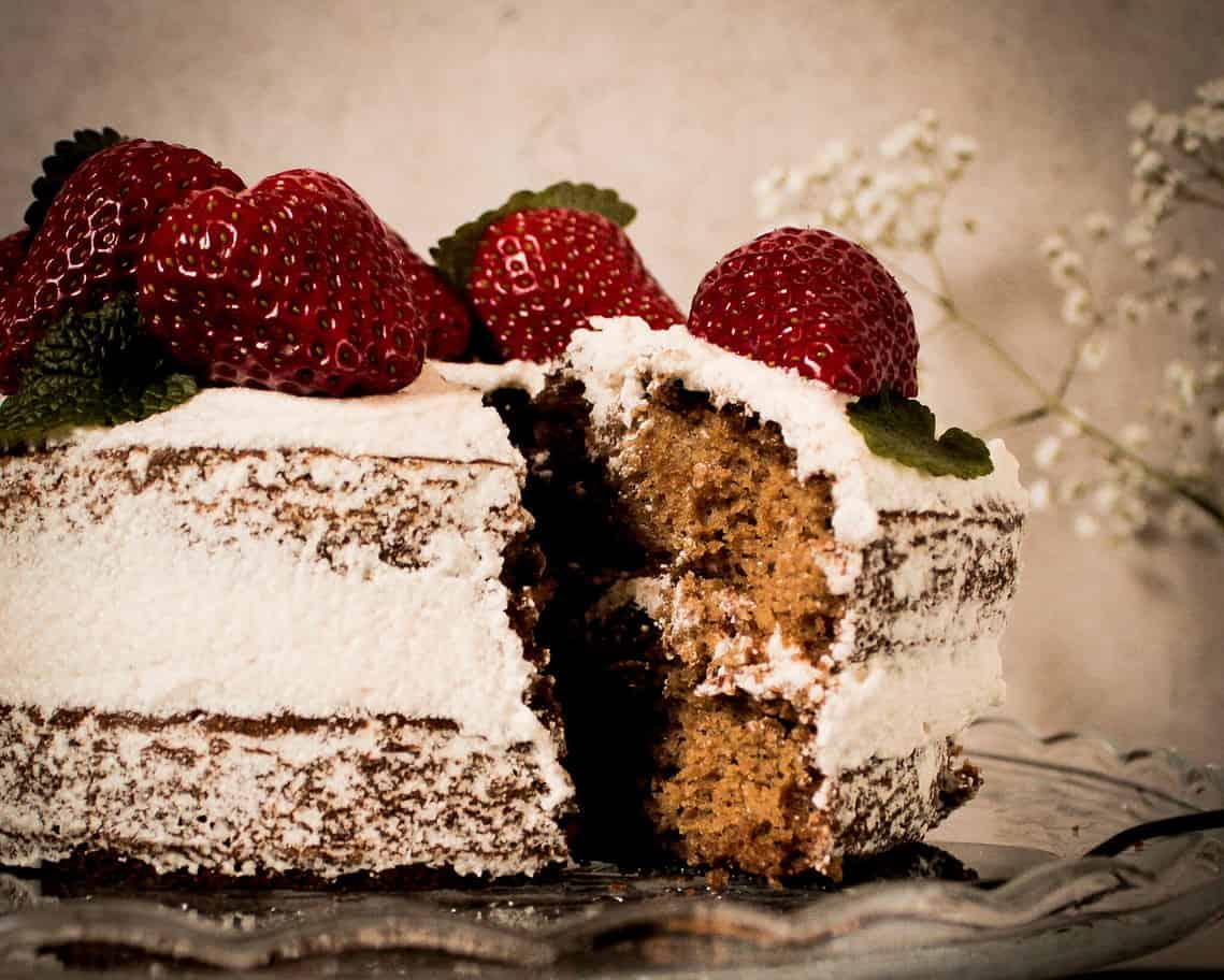 vegan naked cake with strawberries and lemon balm