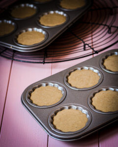 chai madeleines in baking tin